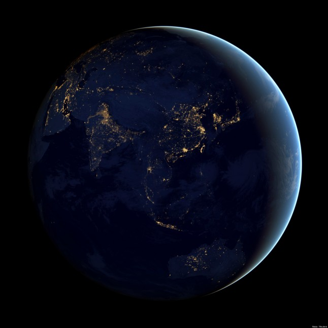 A NASA Earth Observatory handout of a composite image of Asia and Australia at night, assembled from data acquired by the Suomi NPP satellite in April and October 2012