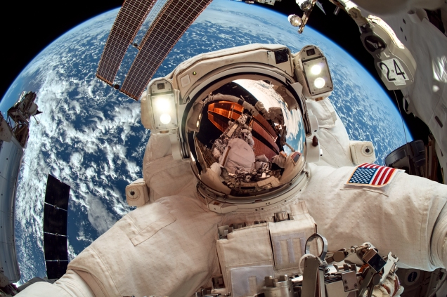 International Space Station and astronaut in outer space over th